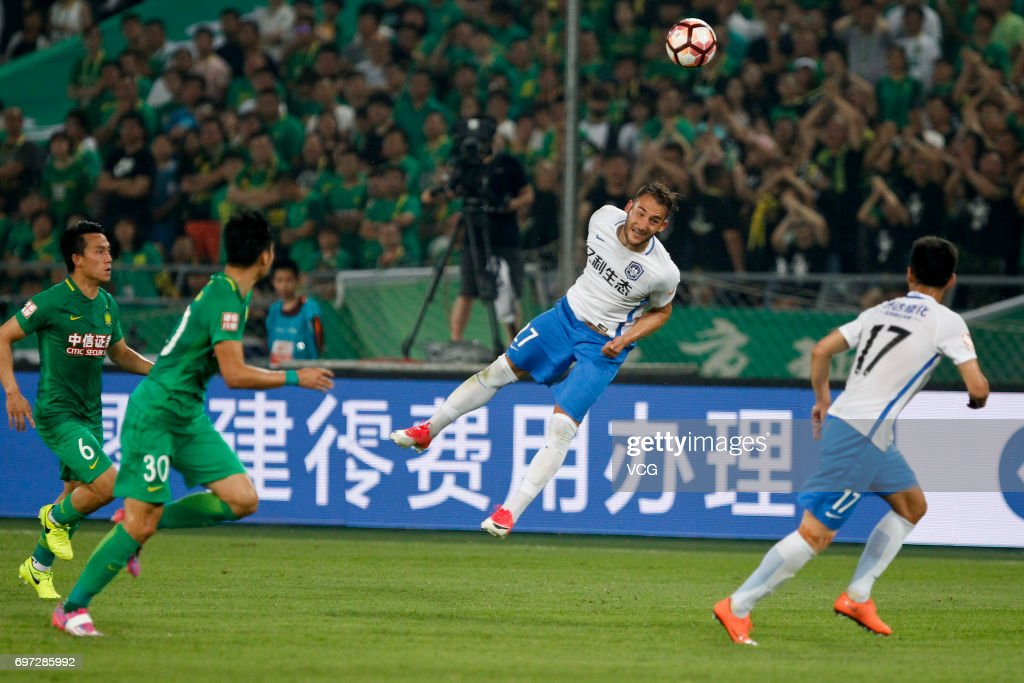 Nemanja Gudelj # 27 of Tianjin Teda heads the ball during the 13th round match of 2017 Chinese Football Association Super League (CSL) between Beijing Guoan and Tianjin Teda at Beijing Workers' Stadium on June 18, 2017 in Beijing, China.