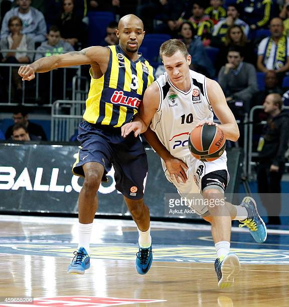 Nemanja Jaramaz, #10 of PGE Turow Zgorzelec competes with Ricky Hickman, #3 of Fenerbahce Ulker Istanbul in action during the 2014-2015 Turkish...