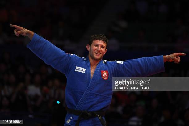 Nemanja Majdov of Serbia celebrates winning the bronze medal after his fight against Krisztian Toth of Hungary in the men's under 90kg category...
