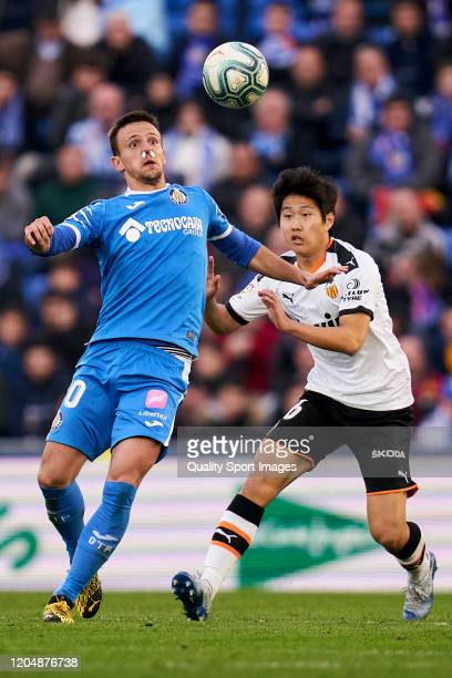 Nemanja Maksimovic of Getafe CF battle for the ball with Kangin Lee of Valencia CF during the Liga match between Getafe CF and Valencia CF at...