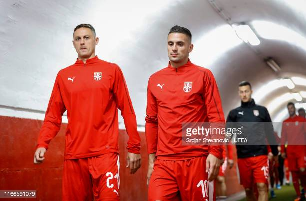 Nemanja Matic and Dusan Tadic of Serbia enter the pitch prior to the UEFA Euro 2020 qualifier between Serbia and Portugal at Stadium Crvena Zvezda on...