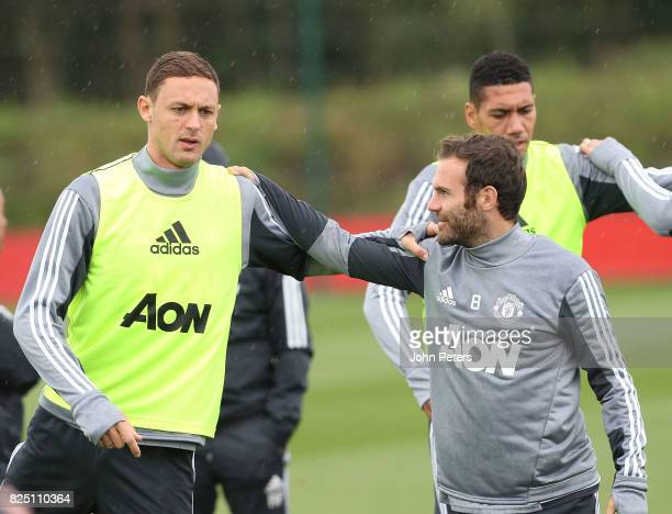 Nemanja Matic and Juan Mata of Manchester United in action during a first team training session at Aon Training Complex on August 1 2017 in...