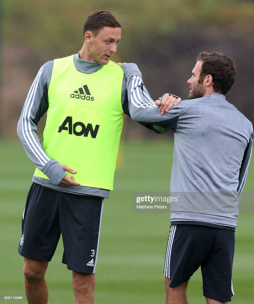 Nemanja Matic and Juan Mata of Manchester United in action during a first team training session at Aon Training Complex on August 1, 2017 in Manchester, England.
