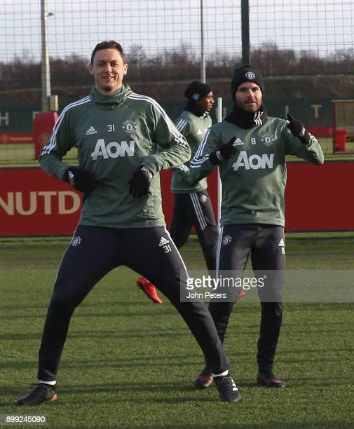 Nemanja Matic and Juan Mata of Manchester United in action during a first team training session at Aon Training Complex on December 28 2017 in...