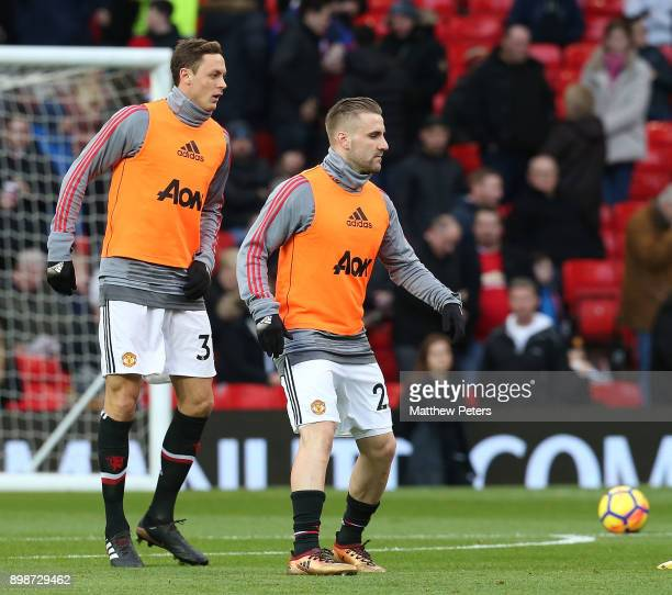 Nemanja Matic and Luke Shaw of Manchester United warm up ahead of the Premier League match between Manchester United and Burnley at Old Trafford on...