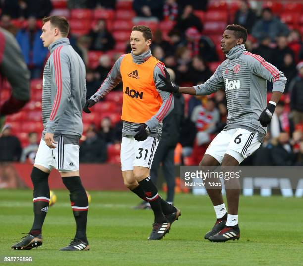 Nemanja Matic and Paul Pogba of Manchester United warm up ahead of the Premier League match between Manchester United and Burnley at Old Trafford on...