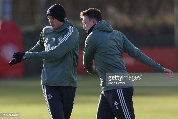 Nemanja Matic and Phil Jones of Manchester United in action during a first team training session at Aon Training Complex on December 28 2017 in...