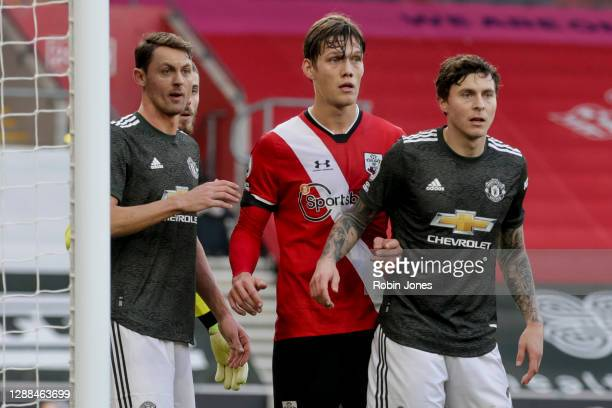 Nemanja Matic and Victor Lindelof of Manchester United with Jannik Vestergaard of Southampton during the Premier League match between Southampton and...