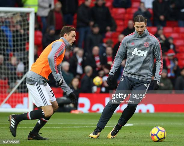 Nemanja Matic and Zlatan Ibrahimovic of Manchester United warm up ahead of the Premier League match between Manchester United and Burnley at Old...
