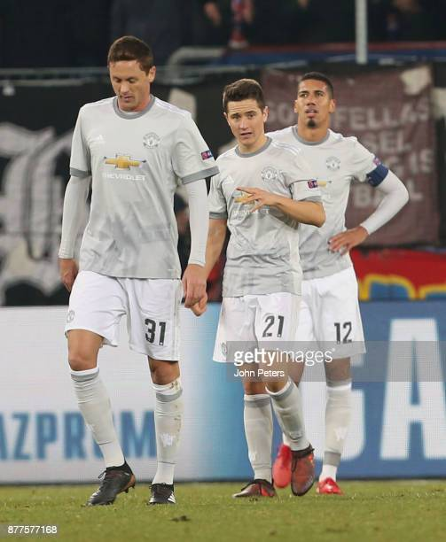 Nemanja Matic Ander Herrera and Chris Smalling of Manchester United shows his disappointment at conceding a goal during the UEFA Champions League...