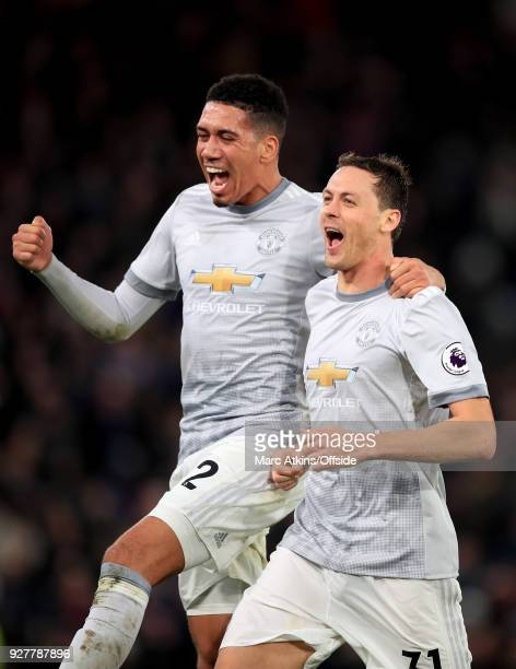 Nemanja Matic celebrates his late winning goal with Chris Smalling during the Premier League match between Crystal Palace and Manchester United at...