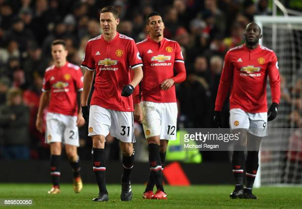 Nemanja Matic Chris Smalling and Romelu Lukaku of Manchester United look dejected after the 2nd MAcnhester City goal during the Premier League match...