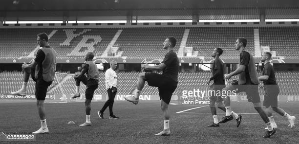 Nemanja Matic Diogo Dalot and Matteo Darmian of Manchester United in action during a training session at Stade de Suisse on September 18 2018 in Bern...