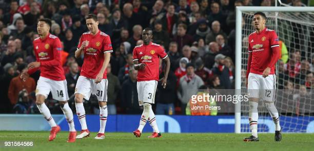 Nemanja Matic Eric Bailly and Chris Smalling of Manchester United react to conceding a goal during the UEFA Champions League Round of 16 Second Leg...