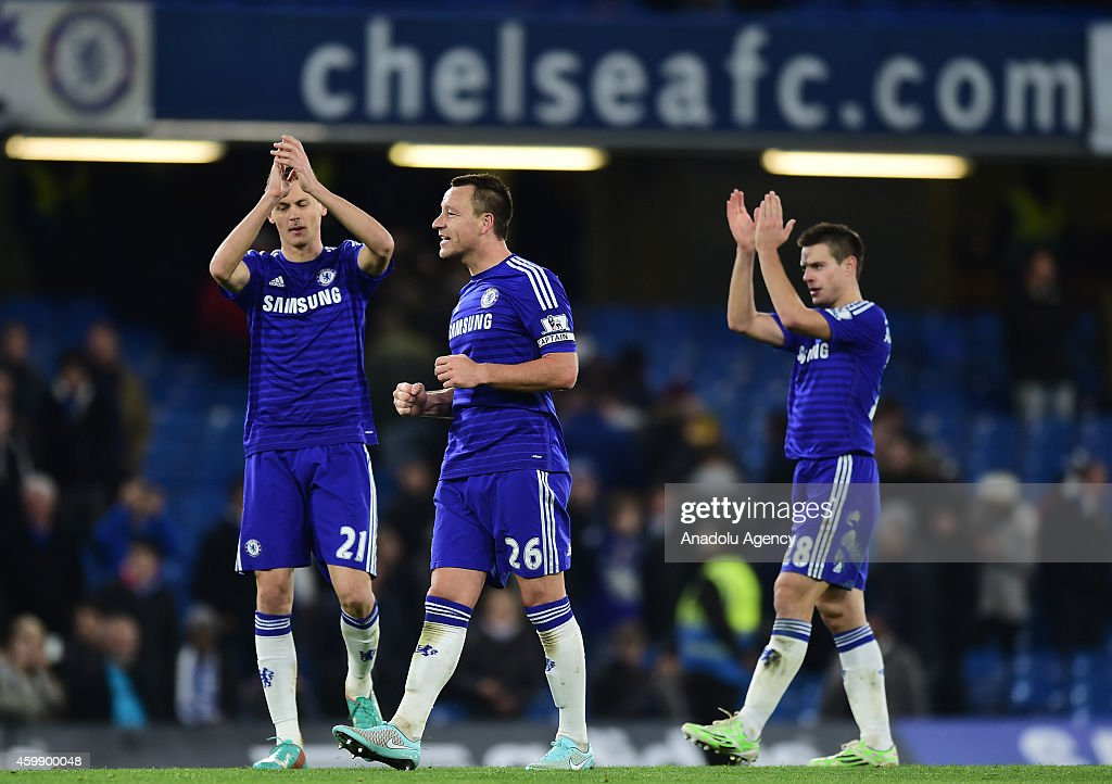 Nemanja Matic, John Terry and Cesar Azpilicueta of Chelsea celebrate victory at the final whistle during the Barclays Premier League match between Chelsea and Tottenham Hotspur at Stamford Bridge in London, England on December 03, 2014.