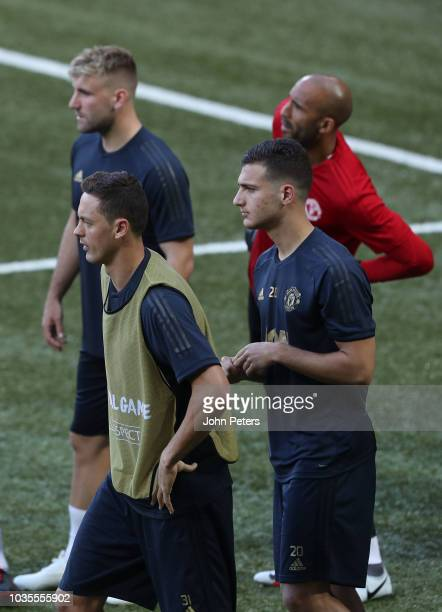 Nemanja Matic Luke Shaw Diogo Dalot and Lee Grant of Manchester United in action during a training session at Stade de Suisse on September 18 2018 in...