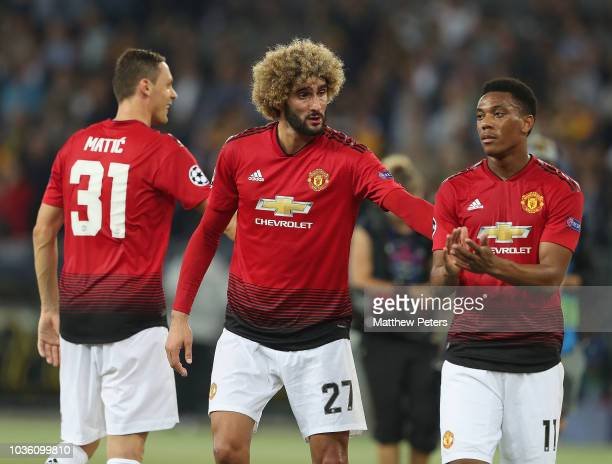 Nemanja Matic Marouane Fellaini and Anthony Martial of Manchester United celebrate after the Group H match of the UEFA Champions League between BSC...
