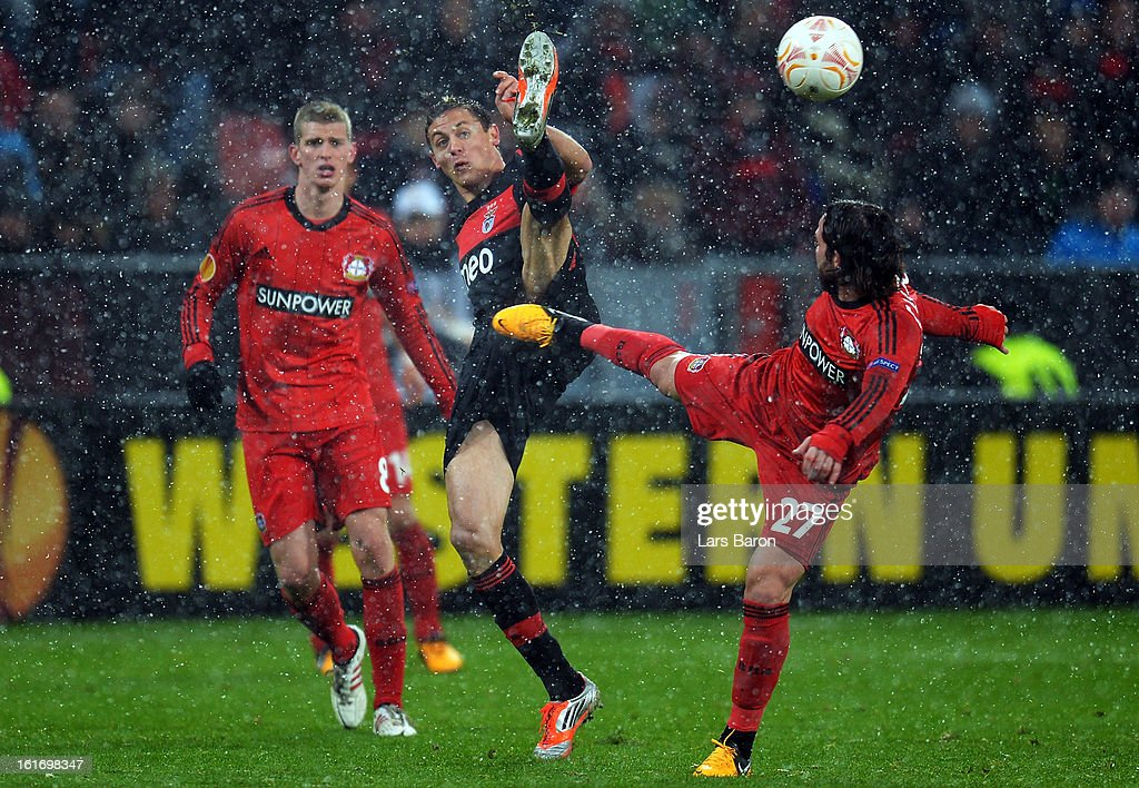 Nemanja Matic of Benfica is challenged by Gonzalo Castro of Leverkusen during the UEFA Europa League Round of 32 first leg between Bayer 04 Leverkusen and SL Benfica at BayArena on February 14, 2013 in Leverkusen, Germany.