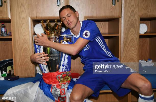 Nemanja Matic of Chelsa poses with the Premier League Trophy after the Premier League match between Chelsea and Sunderland at Stamford Bridge on May...