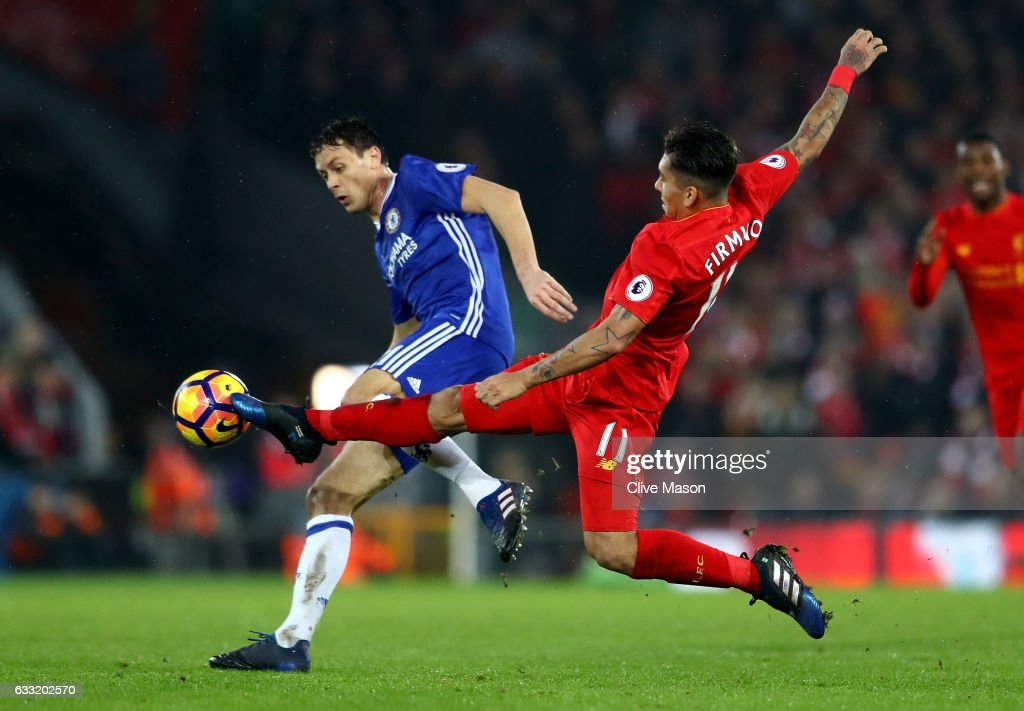 Nemanja Matic of Chelsea and Roberto Firmino of Liverpool compete for the ball during the Premier League match between Liverpool and Chelsea at Anfield on January 31, 2017 in Liverpool, England.