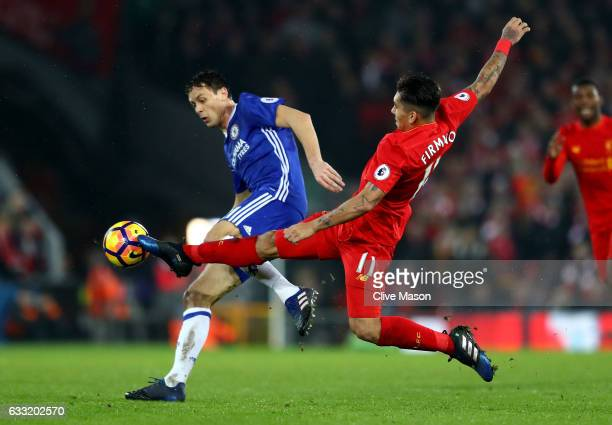 Nemanja Matic of Chelsea and Roberto Firmino of Liverpool compete for the ball during the Premier League match between Liverpool and Chelsea at...