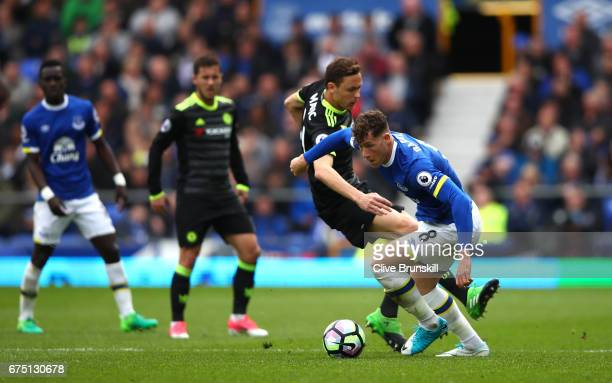 Nemanja Matic of Chelsea and Ross Barkley of Everton battle for possession during the Premier League match between Everton and Chelsea at Goodison...