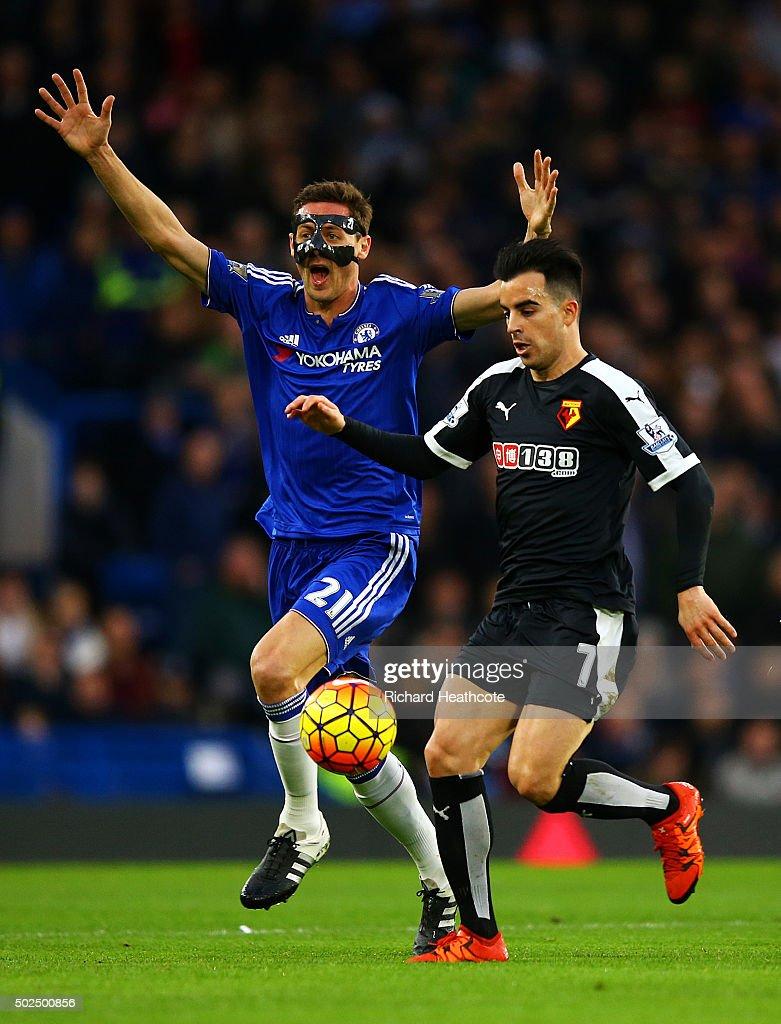 Nemanja Matic of Chelsea appeals as Jose Manuel Jurado of Watford runs through during the Barclays Premier League match between Chelsea and Watford at Stamford Bridge on December 26, 2015 in London, England.