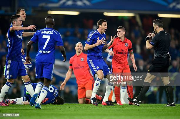 Nemanja Matic of Chelsea appeals to referee Bjorn Kuipers of the Netherlands following a bad tackle on teammate Oscar of Chelsea by Zlatan...