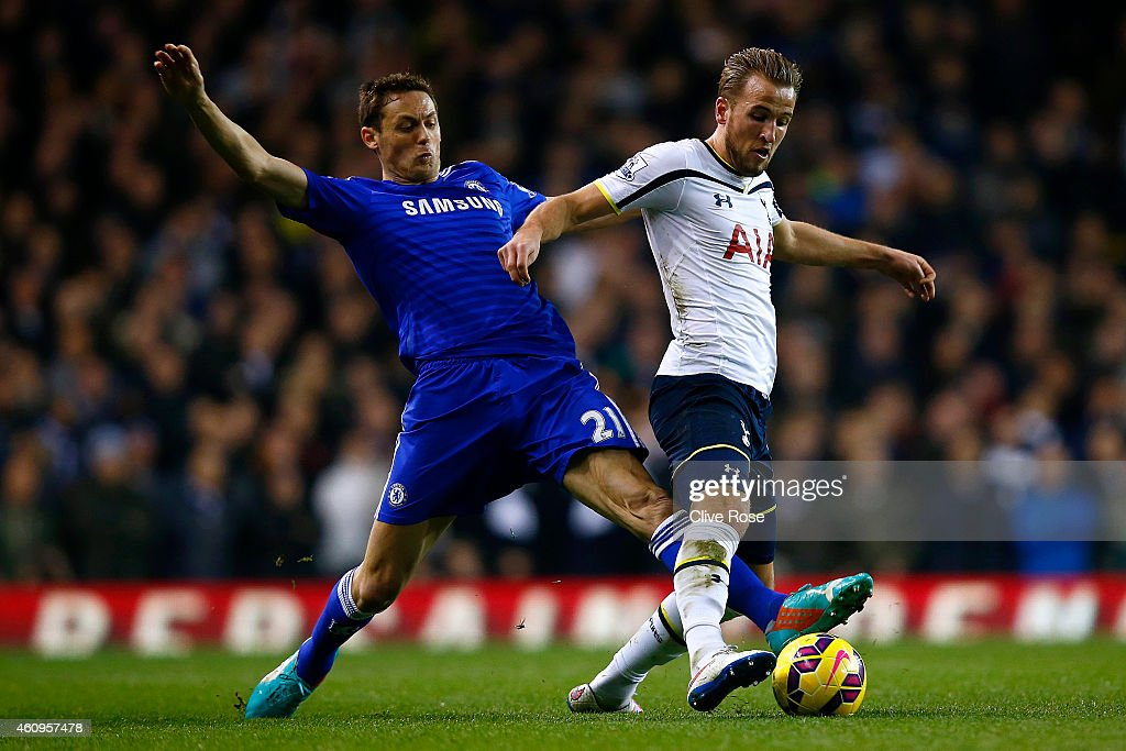 Nemanja Matic of Chelsea battles for the ball with Harry Kane of Spurs during the Barclays Premier League match between Tottenham Hotspur and Chelsea at White Hart Lane on January 1, 2015 in London, England.