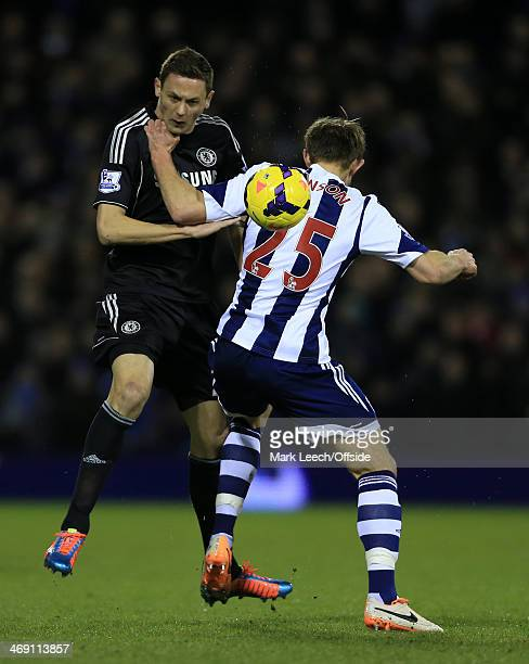 Nemanja Matic of Chelsea battles with Craig Dawson of West Brom during the Barclays Premier League match between West Bromwich Albion and Chelsea at...