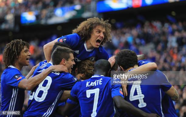 Nemanja Matic of Chelsea celebrates with team mates and David Luiz after he scores his sides fourth goal during The Emirates FA Cup SemiFinal between...