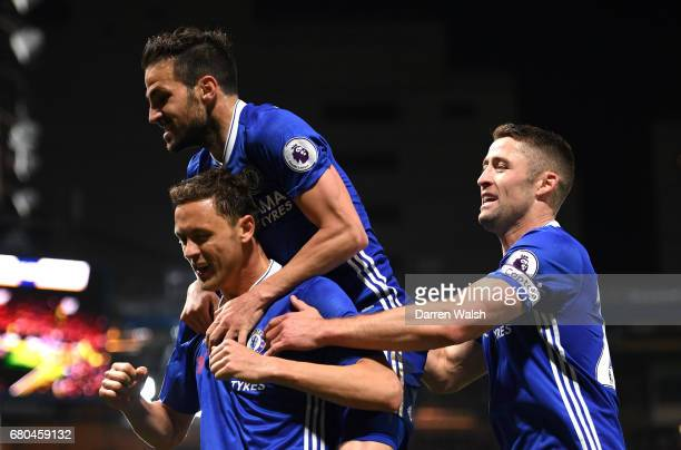 Nemanja Matic of Chelsea celebrates with tem mates after scoring his sides third goal during the Premier League match between Chelsea and...