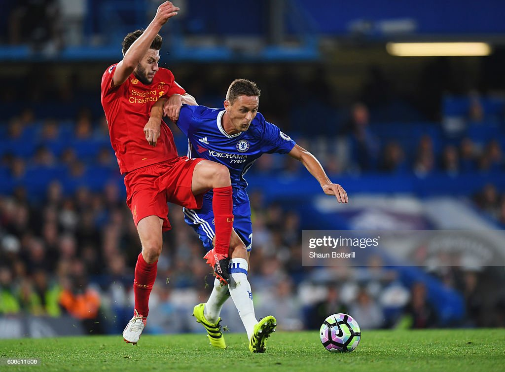 Nemanja Matic of Chelsea holds off Adam Lallana of Liverpool during the Premier League match between Chelsea and Liverpool at Stamford Bridge on September 16, 2016 in London, England.