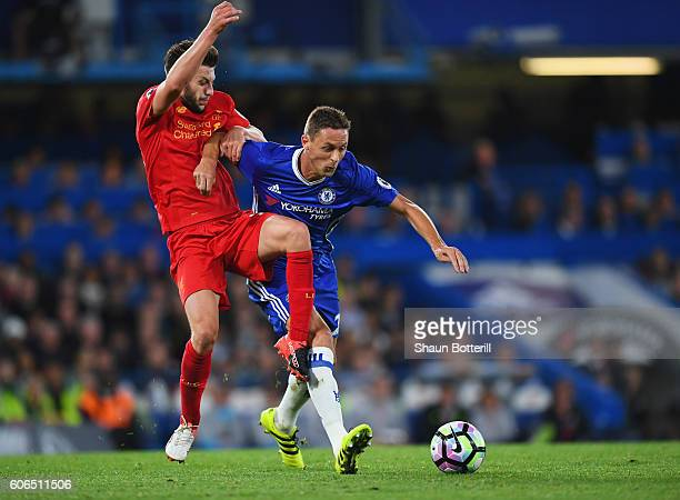 Nemanja Matic of Chelsea holds off Adam Lallana of Liverpool during the Premier League match between Chelsea and Liverpool at Stamford Bridge on...