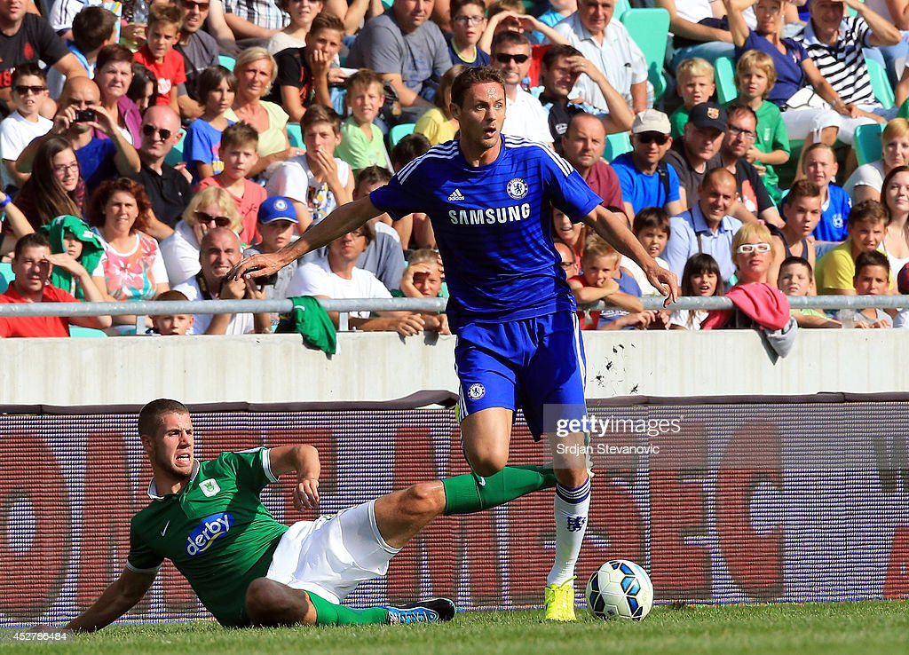 Nemanja Matic (R) of Chelsea in action against Kenan Bajric (L) of FC Olimpija Ljubljana during the Pre Season Friendly match between FC Olimpija Ljubljana and Chelsea at Stozice stadium in Ljubljana, Slovenia on Sunday, July 27, 2014.
