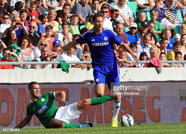 Nemanja Matic of Chelsea in action against Kenan Bajric of FC Olimpija Ljubljana during the Pre Season Friendly match between FC Olimpija Ljubljana...