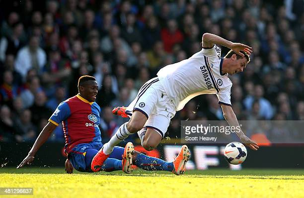 Nemanja Matic of Chelsea is brought down by Kagisho Dikgacoi of Crystal Palace during the Barclays Premier League match between Crystal Palace and...