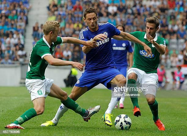 Nemanja Matic of Chelsea is challenged by Nik Omladic of Olimpija Ljubljana the Pre Season Friendly match between FC Olimpija Ljubljana and Chelsea...