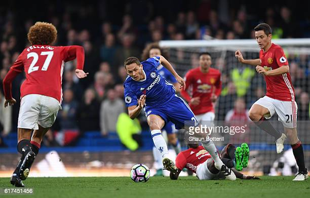Nemanja Matic of Chelsea is tackled by Ander Herrera of Manchester United and Eric Bailly of Manchester United during the Premier League match...
