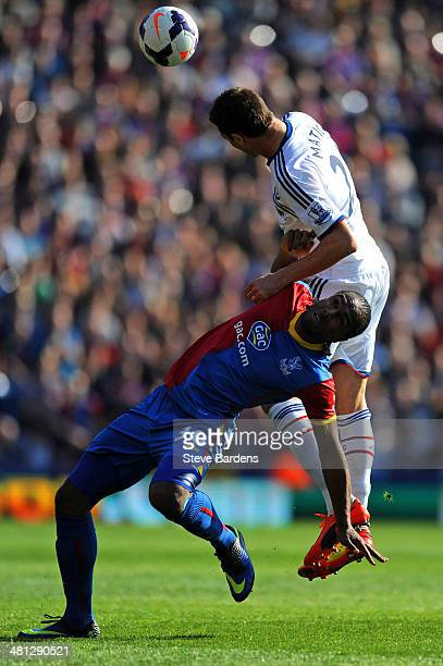 Nemanja Matic of Chelsea risea above Cameron Jerome of Crystal Palace to head the ball clear during the Barclays Premier League match between Crystal...