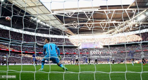 Nemanja Matic of Chelsea scores his sides fourth goal as Hugo Lloris of Tottenham Hotspur watches on during The Emirates FA Cup SemiFinal between...
