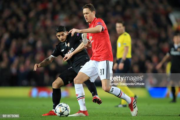 Nemanja Matic of Man Utd battles with Ever Banega of Sevilla during the UEFA Champions League Round of 16 Second Leg match between Manchester United...