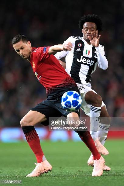 Nemanja Matic of Man Utd battles with Juan Cuadrado of Juventus during the Group H match of the UEFA Champions League between Manchester United and...