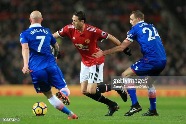 Nemanja Matic of Man Utd battles with Stephen Ireland of Stoke and Darren Fletcher of Stoke during the Premier League match between Manchester United...