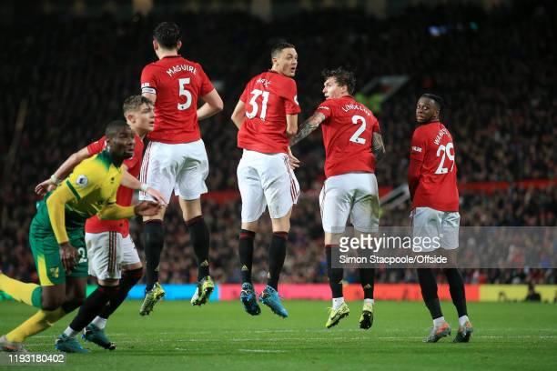 Nemanja Matic of Man Utd jumps in the defensive wall alongside Victor Lindelof of Man Utd and Aaron WanBissaka of Man Utd during the Premier League...