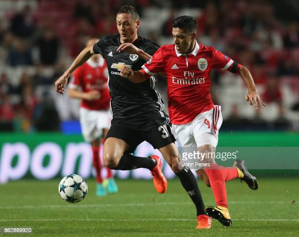 Nemanja Matic of Mancester United in action with Raul Jimenez of Benfica during the UEFA Champions League group A match between SL Benfica and...