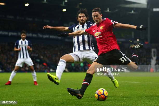 Nemanja Matic of Manchester United and Ahmed Hegazy of West Bromwich Albion in action during the Premier League match between West Bromwich Albion...