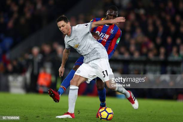 Nemanja Matic of Manchester United and Christian Benteke of Crystal Palace during the Premier League match between Crystal Palace and Manchester...