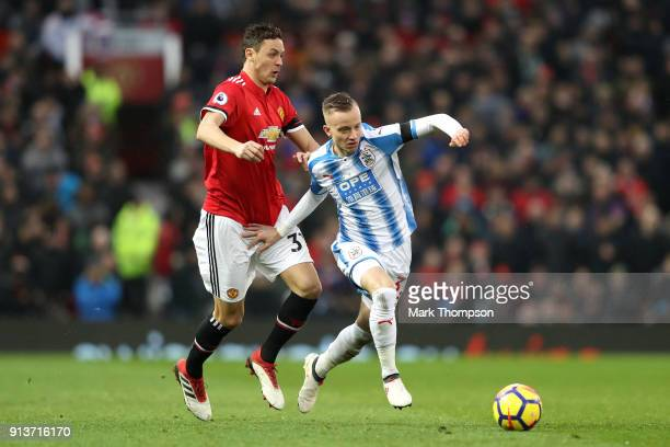 Nemanja Matic of Manchester United and Florent Hadergjonaj of Huddersfield Town battle for the ball during the Premier League match between...