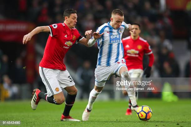 Nemanja Matic of Manchester United and Florent Hadergjonaj of Huddersfield Town during the Premier League match between Manchester United and...